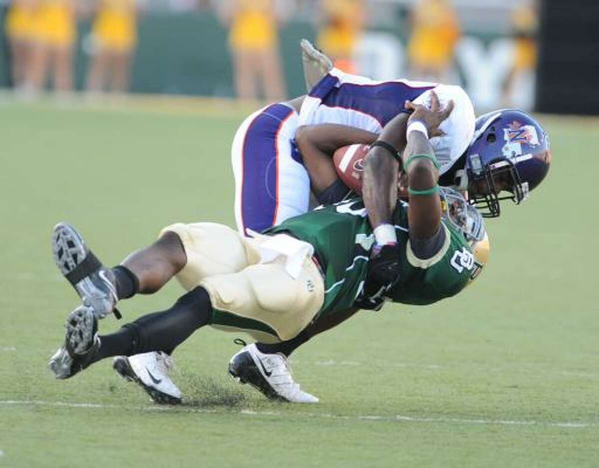 Northwestern State's Gary Riggs sacks Baylor quarterback Robert Griffin in the first quarter Saturday.
