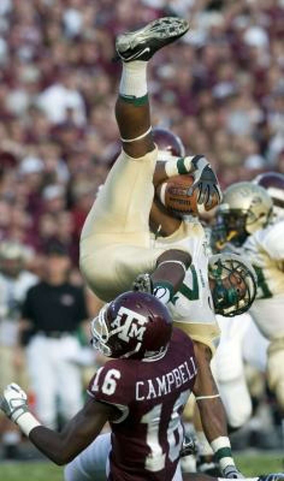 UAB's Frantrell Forrest, top, is tackled by Texas A&M's Stephen Campbell on a kickoff return during the first quarter Saturday.