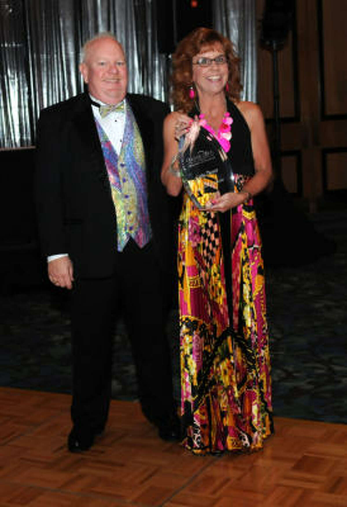 Clear Lake Area Chamber outgoing chairman Cathy Turner was given an award from new chairman Michael Divine.