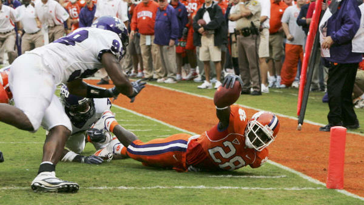 Clemson's CJ Spiller falls short of a touchdown as TCU's Tejay Johnson and Jerry Hughes (98) make the stop during the first half of Saturday afternoon's game in Clemson, S.C.