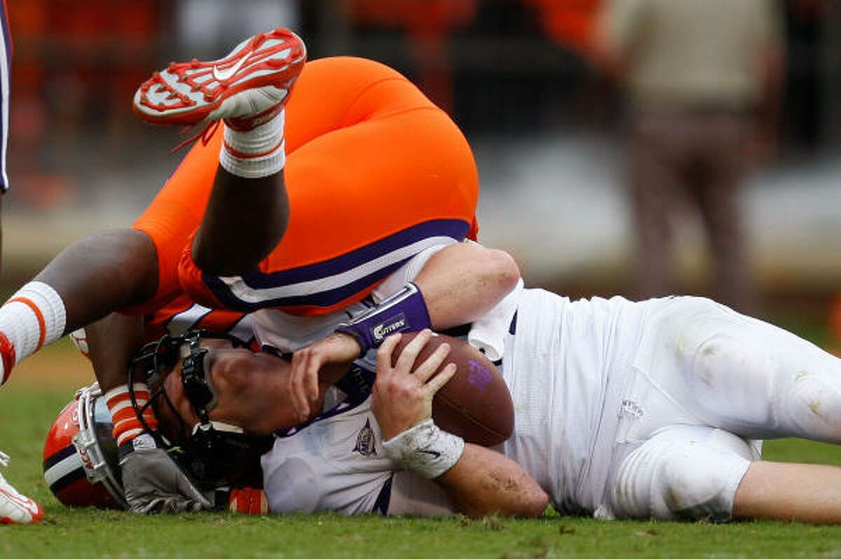 TCU's Andy Dalton gets hit hard by a Clemson defender.