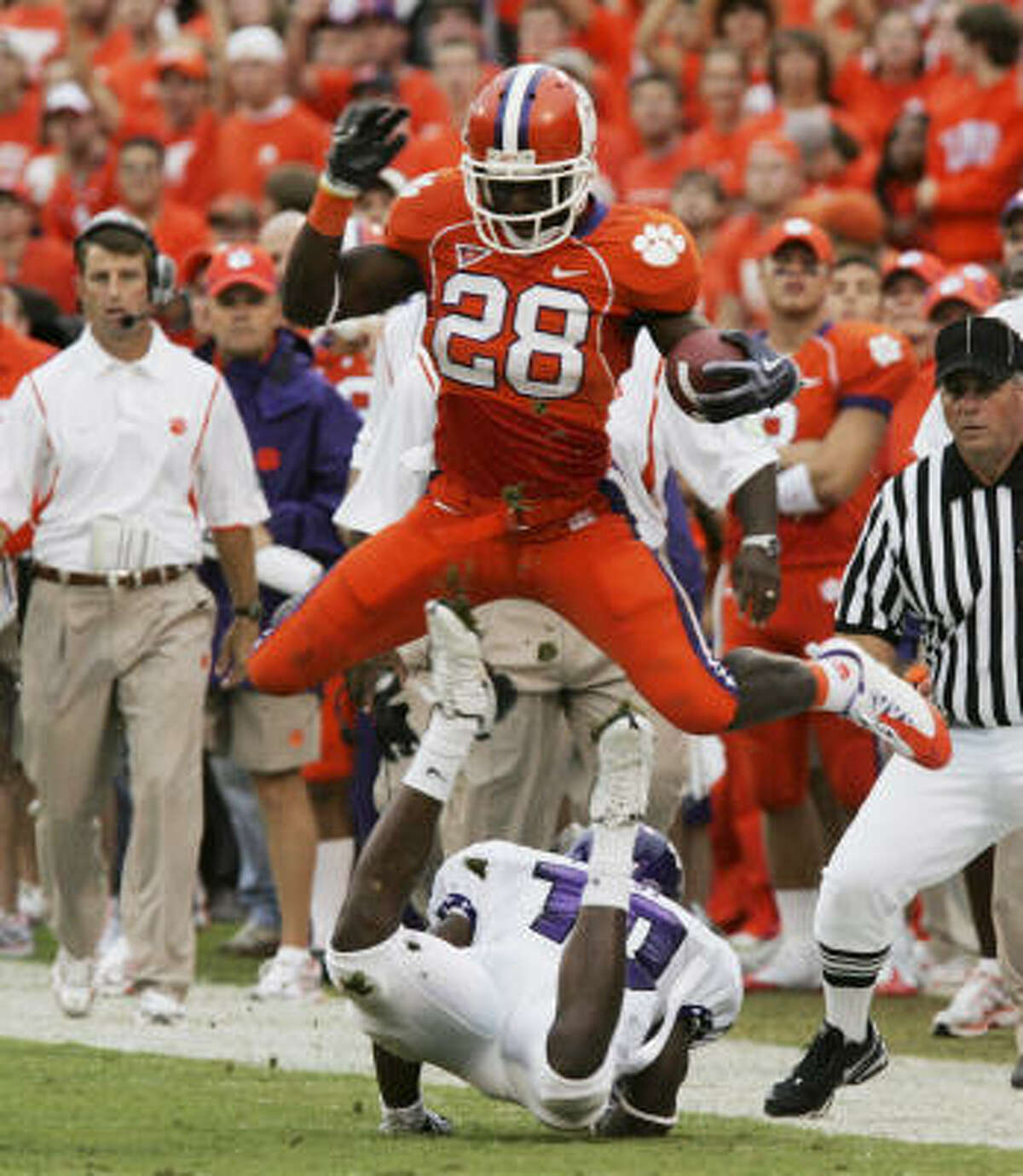 Clemson's C.J. Spiller jumps over TCU's Rafael Priest during the first half.