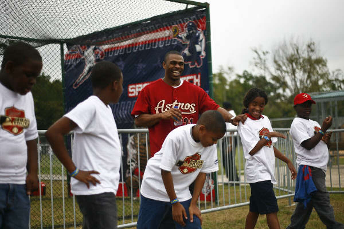 Michael Bourn, the National League's stolen base leader, helps students with a base-running drill during the ground-breaking festivities for the new Houston Astros MLB Urban Youth Academy at Sylvester Turner Park.