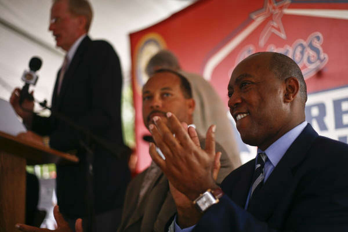 State Representative Sylvester Turner, right, listens during the inauguration festivities.