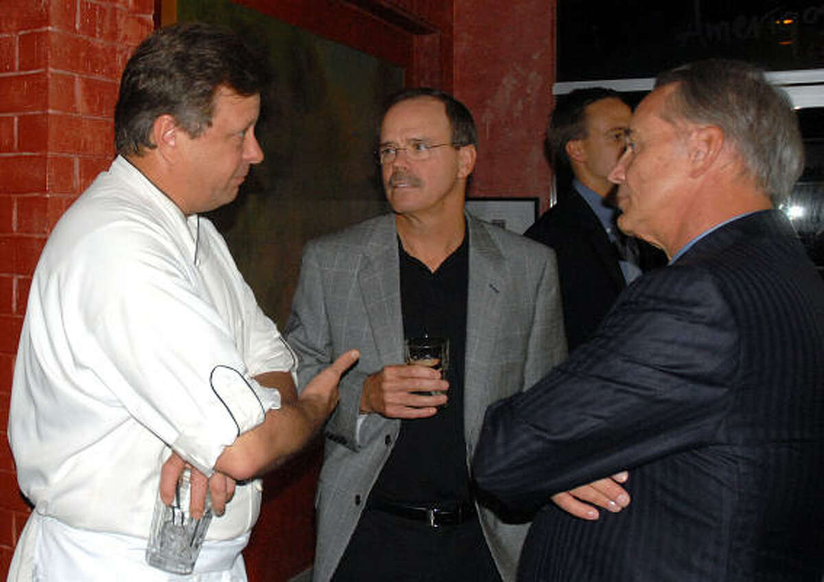Connoisseurs for Charity: Chef Mark Cox discusses the menu with Robert Marling and Michael Galewood during the Woodforest Charitable Foundation's Connoisseurs for Charity culinary extravaganza at Amerigo's Grill.
