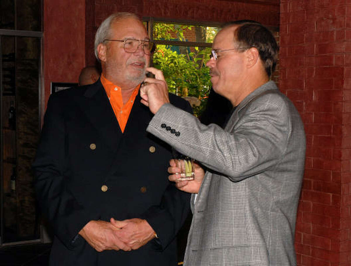 Jim Blair and Robert Marling visit during the Woodforest Charitable Foundation's fundraiser.