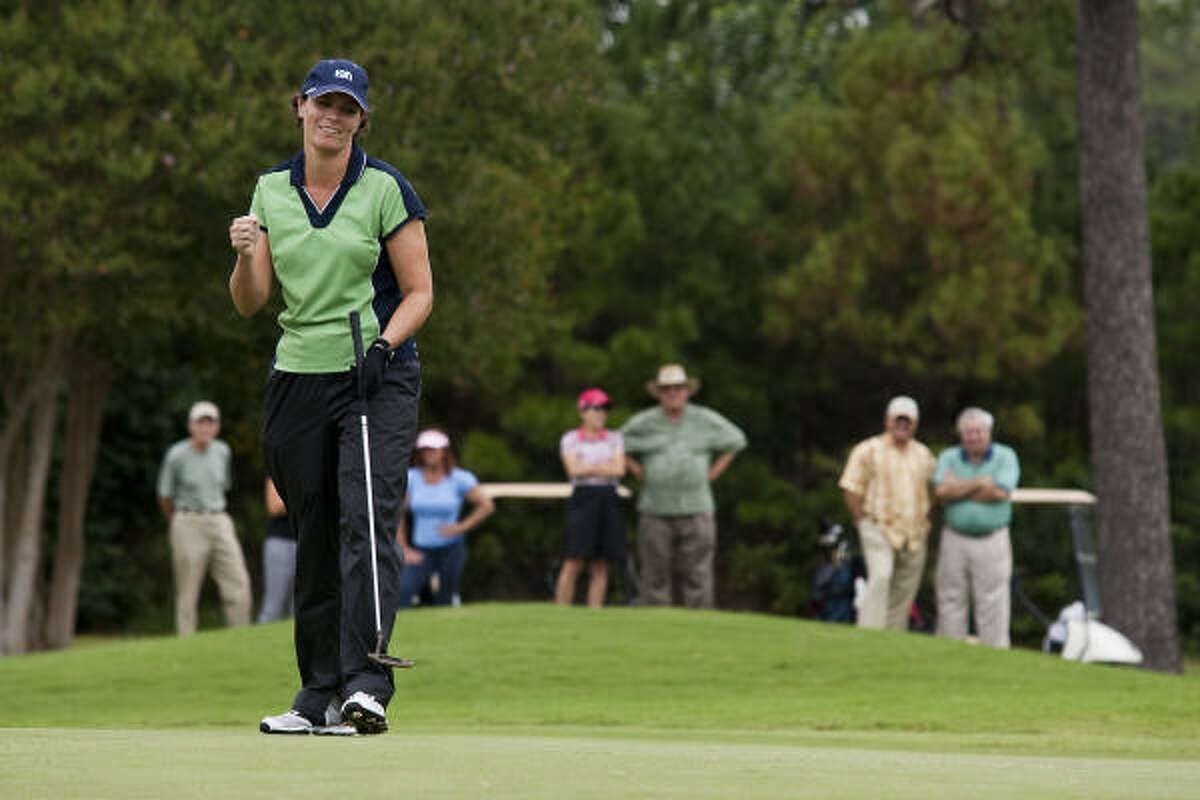 Shelly Serres celebrates sinking her last putt on the 18th hole to finish the 41st Women's City Amateur Championship on Thursday at Memorial Park Golf Course.