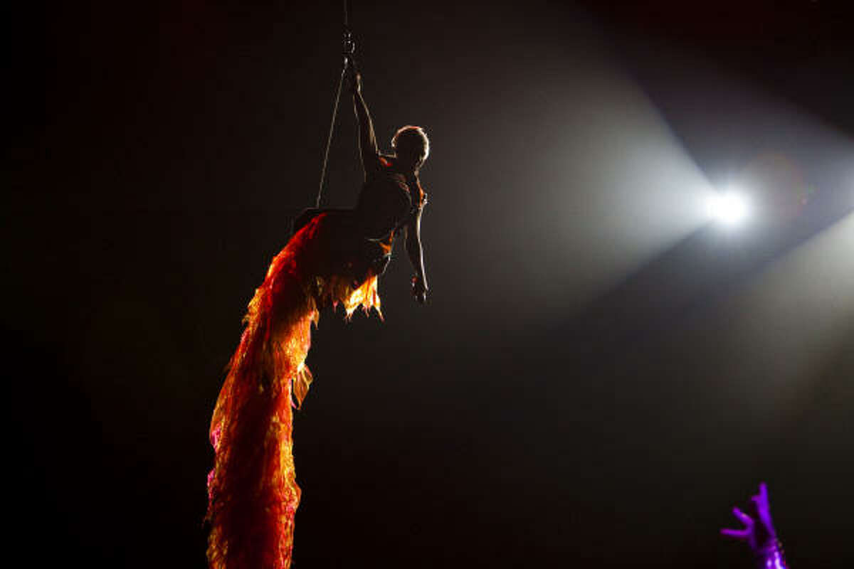 Pink emerges suspended from a cable as she opens her show at the Toyota Center Thursday in Houston.