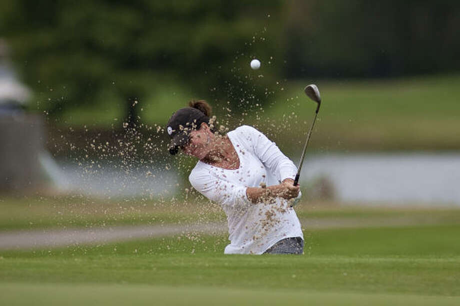 Robin Burke chips out of a sand trap on the 17th hole. Photo: Nathan Lindstrom, For The Chronicle