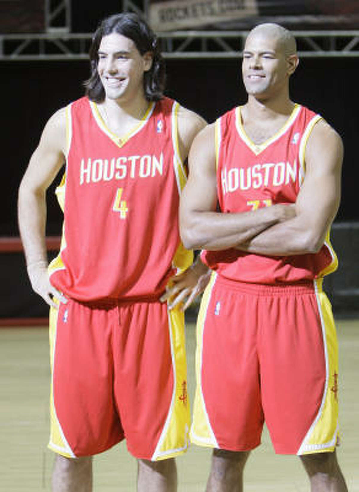 New alternate uniform Houston Rockets players Luis Scola, left, and Shane Battier pose for the media at the unveiling of the team's new alternate uniform.
