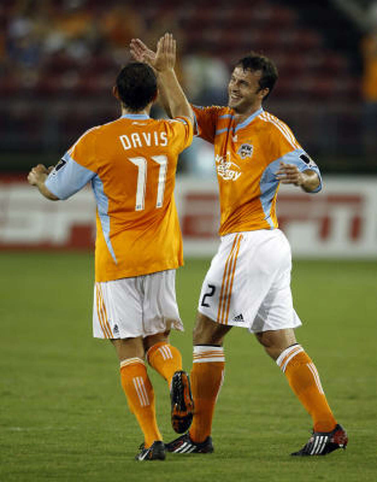 Eddie Robinson, right, celebrates his goal with Brad Davis during first half action. Robinson was making his return from preseason knee surgery.
