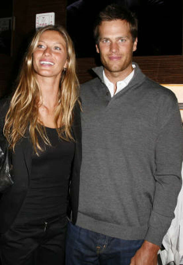 Photographers, Yuri Cortez and Rolando Aviles, have filed a lawsuit in New York against Brady and Bündchen seeking over $1 million in damages over the incident. Photo: Amy Sussman, Getty Images