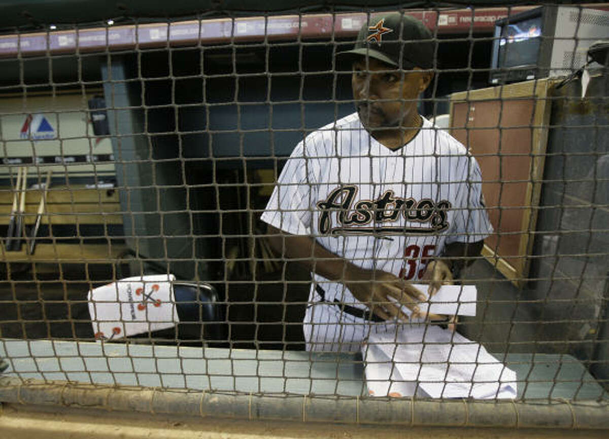 Astros interim manager Dave Clark looks onto the field before game against the St. Louis Cardinals.