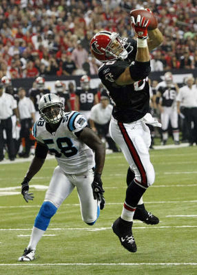 Falcons 28, Panthers 20Falcons tight end Tony Gonzalez beats the coverage of Panthers linebacker Thomas Davis for a touchdown reception during the first quarter of Sunday's game. Photo: CURTIS COMPTON, MCT