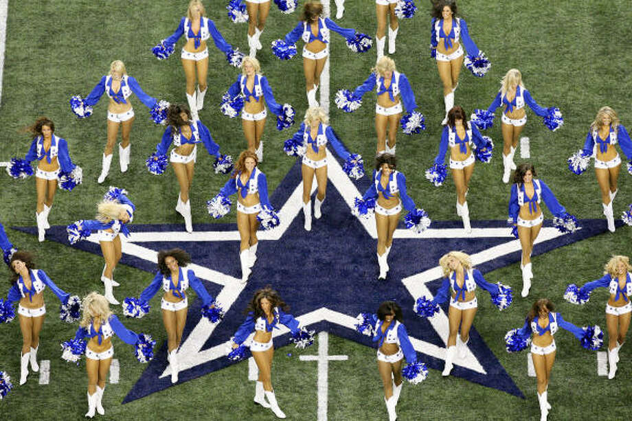 The Dallas Cowboys cheerleaders perform before the game. Photo: EDWARD A. ORNELAS, SAN ANTONIO EXPRESS-NEWS