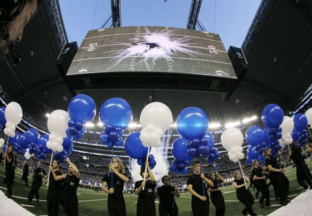 The large video screen hanging over the field shows pyrotechnics as the Dallas Cowboys star is unveiled on the field before the Sunday's game.