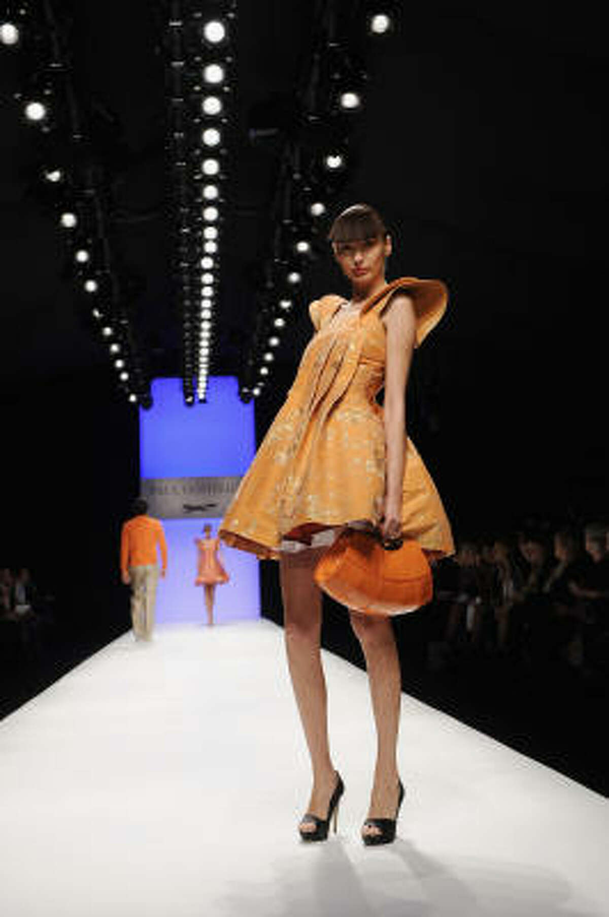 A model walks the catwalk during the Paul Costelloe fashion show. London's fashion week runs Sept. 18-23.