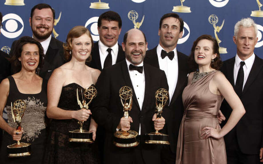 Cast and crew of AMC's Mad Men bask in Emmy glow after winning best drama for the second year in a row. Photo: Matt Sayles, Associated Press