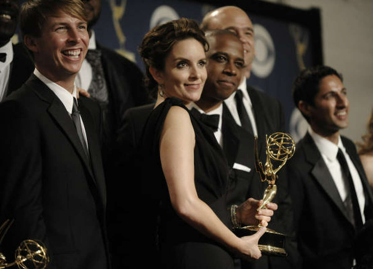 Tina Fey and other cast members from her hit NBC show, 30 Rock, show off their trophy for top comedy. It's the second one for the show.