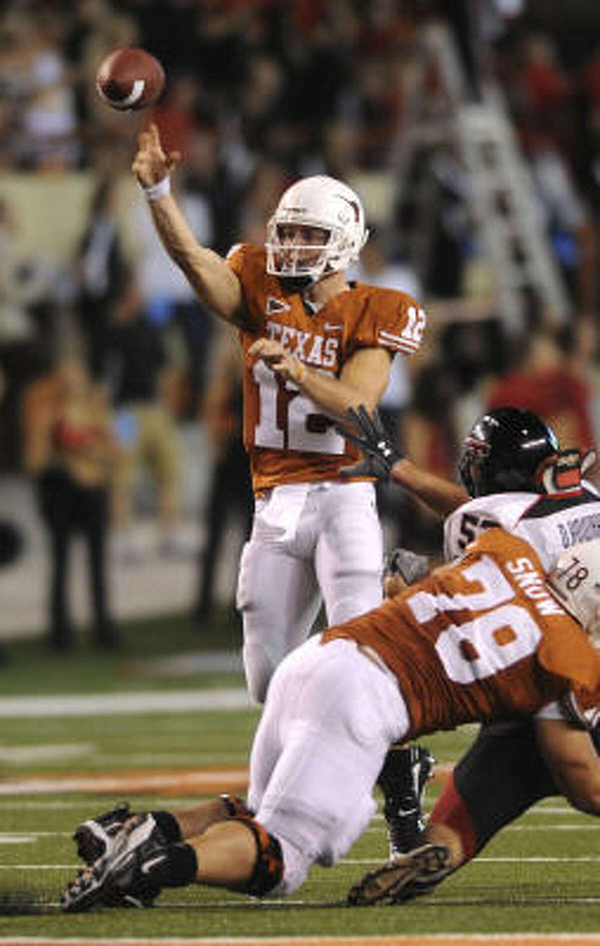 Texas quarterback Colt McCoy completes a pass during the second half.