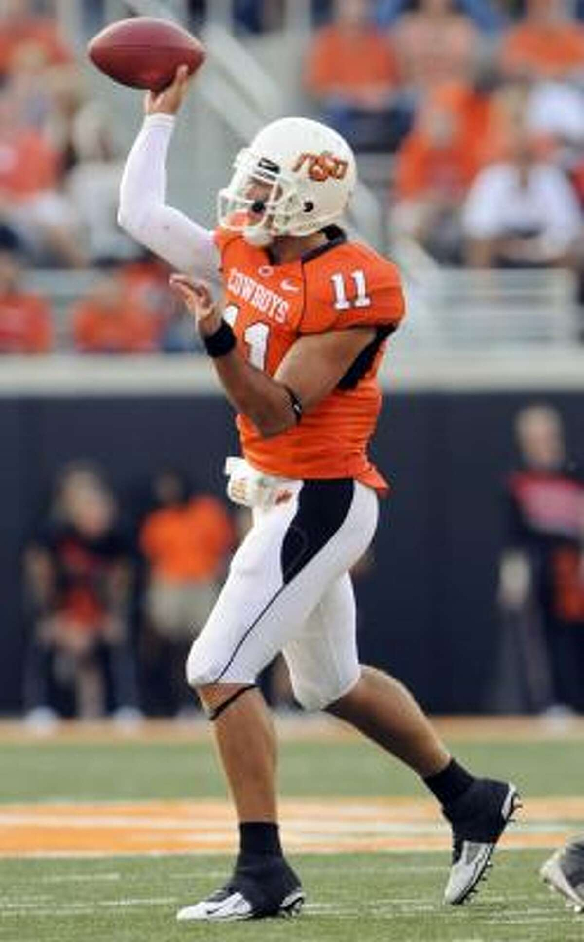 Oklahoma State quarterback Zac Robinson throws a pass during the second half.