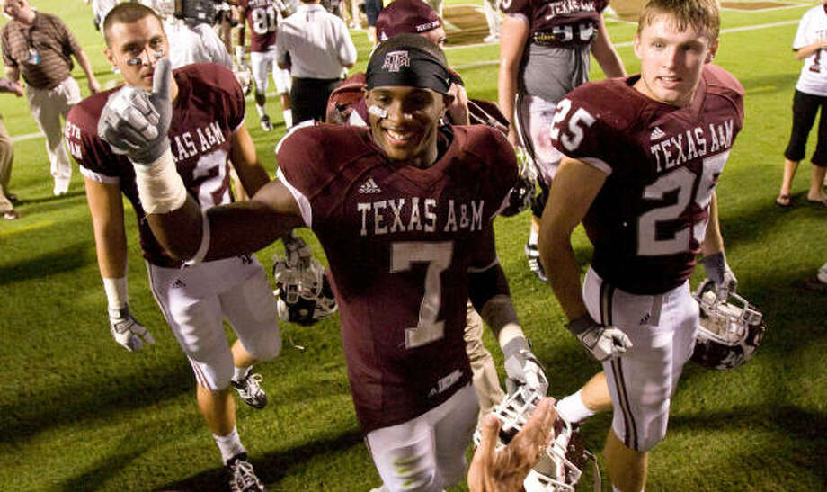 Texas A&M wide receiver Uzoma Nwachukwu (7) celebrates with fans as he walks away from the field after Saturday night's game in College Station. Photo: Nick De La Torre, Chronicle