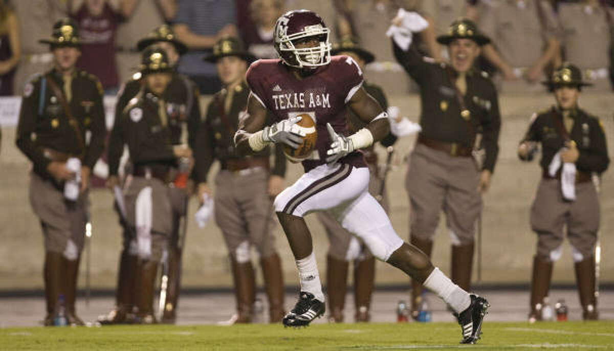 Wide-open A&M receiver Uzoma Nwachukwu looks around as he strides in for a touchdown during the third quarter.