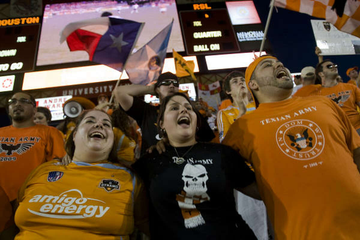 Dynamo fans celebrate after a goal by Geoff Cameron in the fifth minute of the game put their team ahead 2-0.