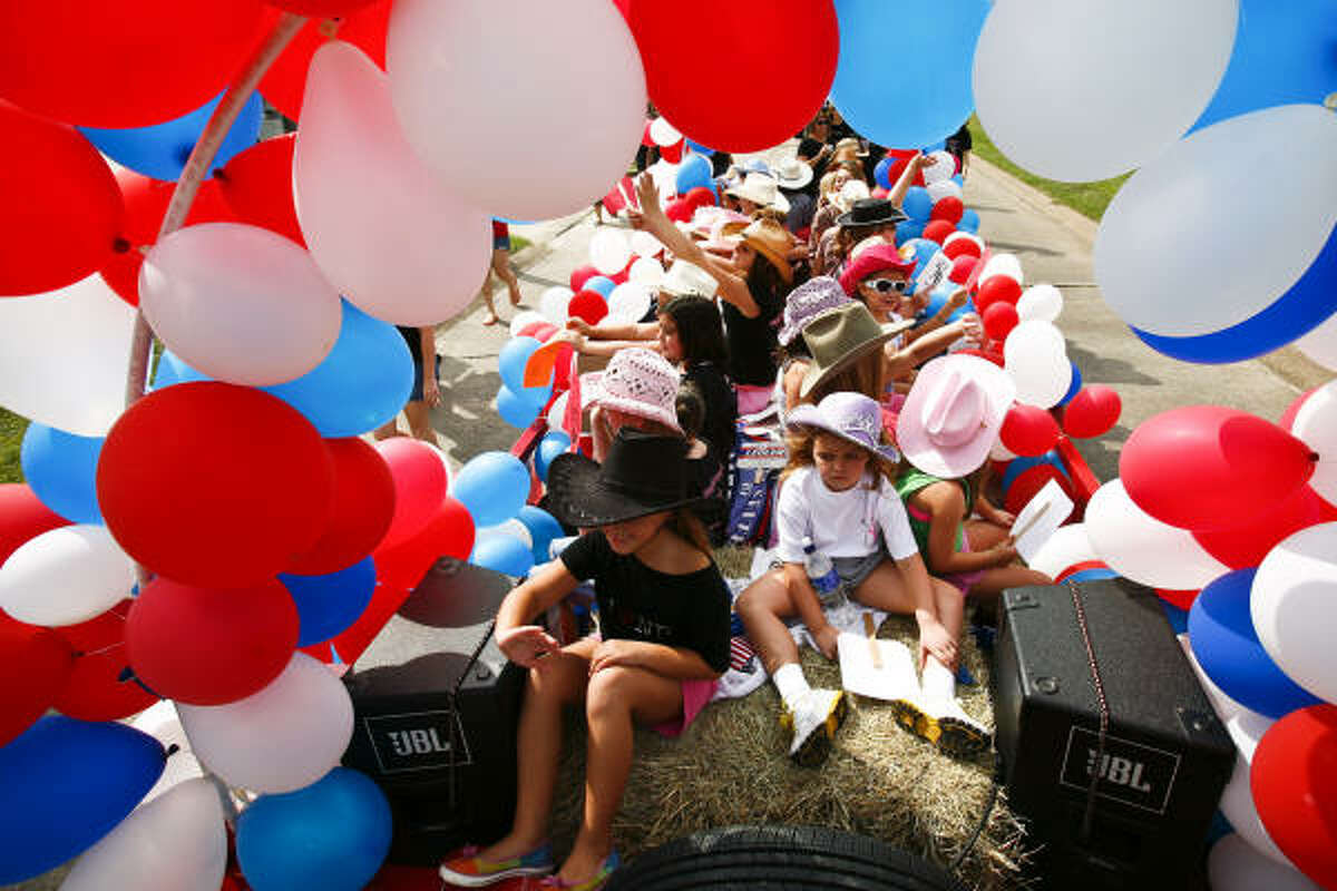 Members of the No Boundaries Dance Studio ride their float during the 2009 Pasadena Livestock Show and Rodeo Parade.
