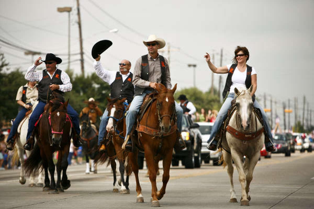 Parade participants ride their horses.
