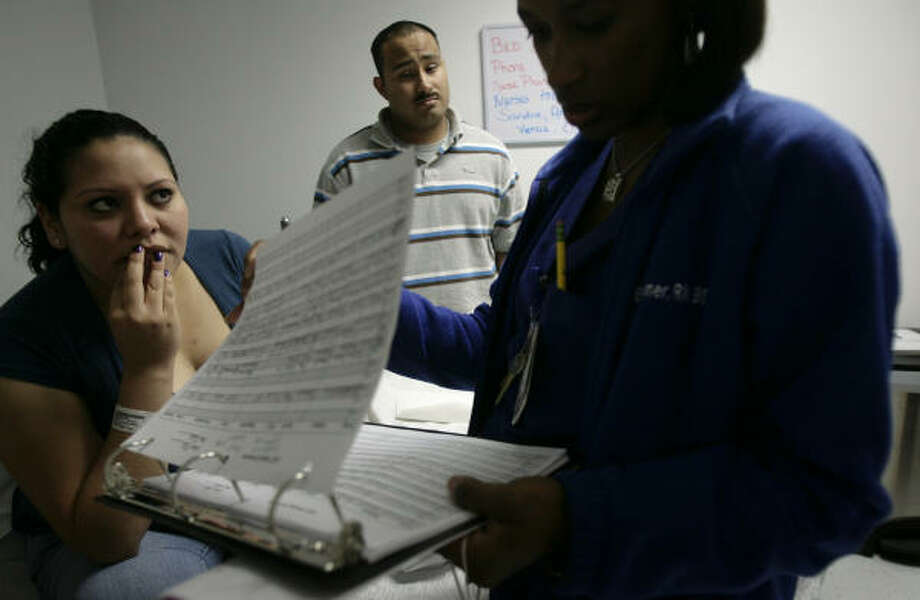 Laura and Antonio await test results during a prenatal visit.  The nurse informs them that the baby is fine, but Laura will need to stay on bed rest. Photo: Mayra Beltran, Chronicle
