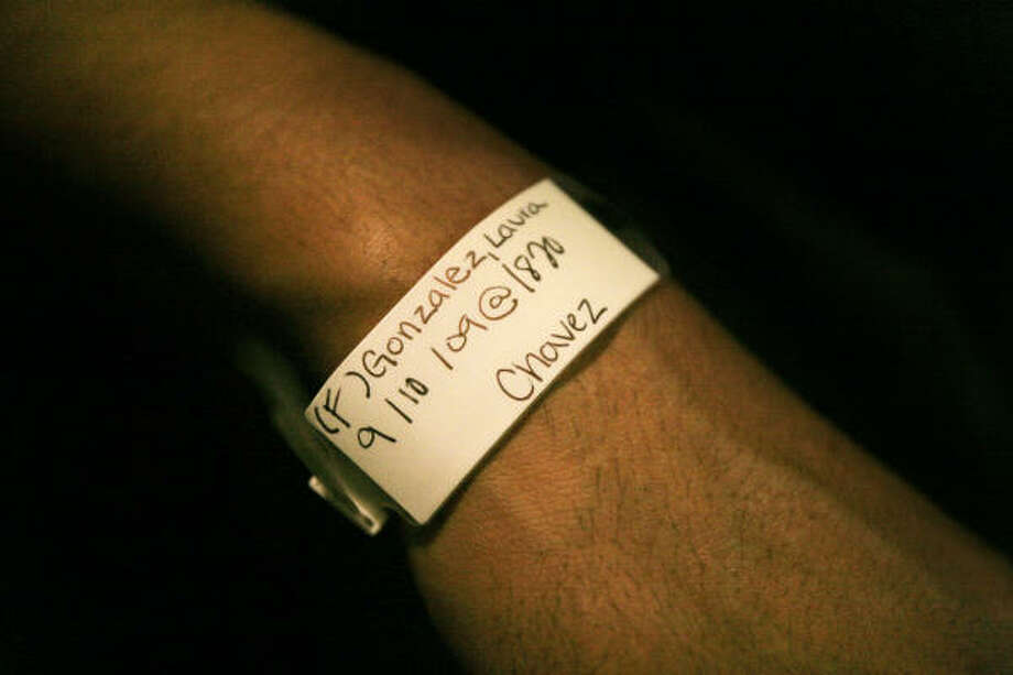 Antonio wears the hospital bracelet that he later folded up and tucked into his wallet. He will take it to Iraq for good luck. Photo: Mayra Beltran, Chronicle