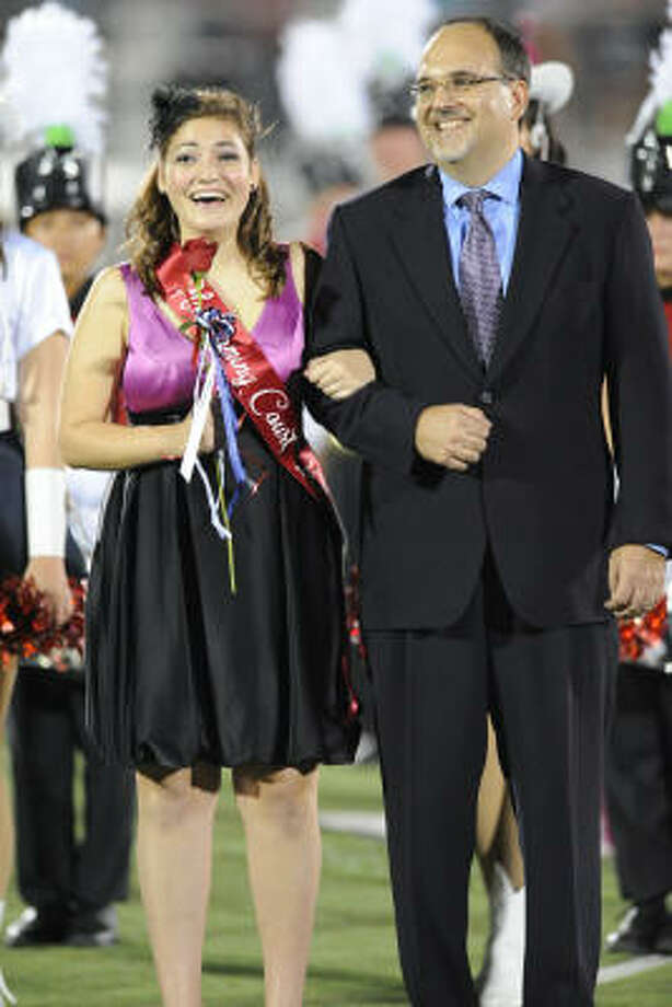 Jennifer Potter reacts to being named Dawson Homecoming Queen.  Jennifer was escorted by her dad Richard Potter. Photo: Ronnie Montgomery, For The Chronicle