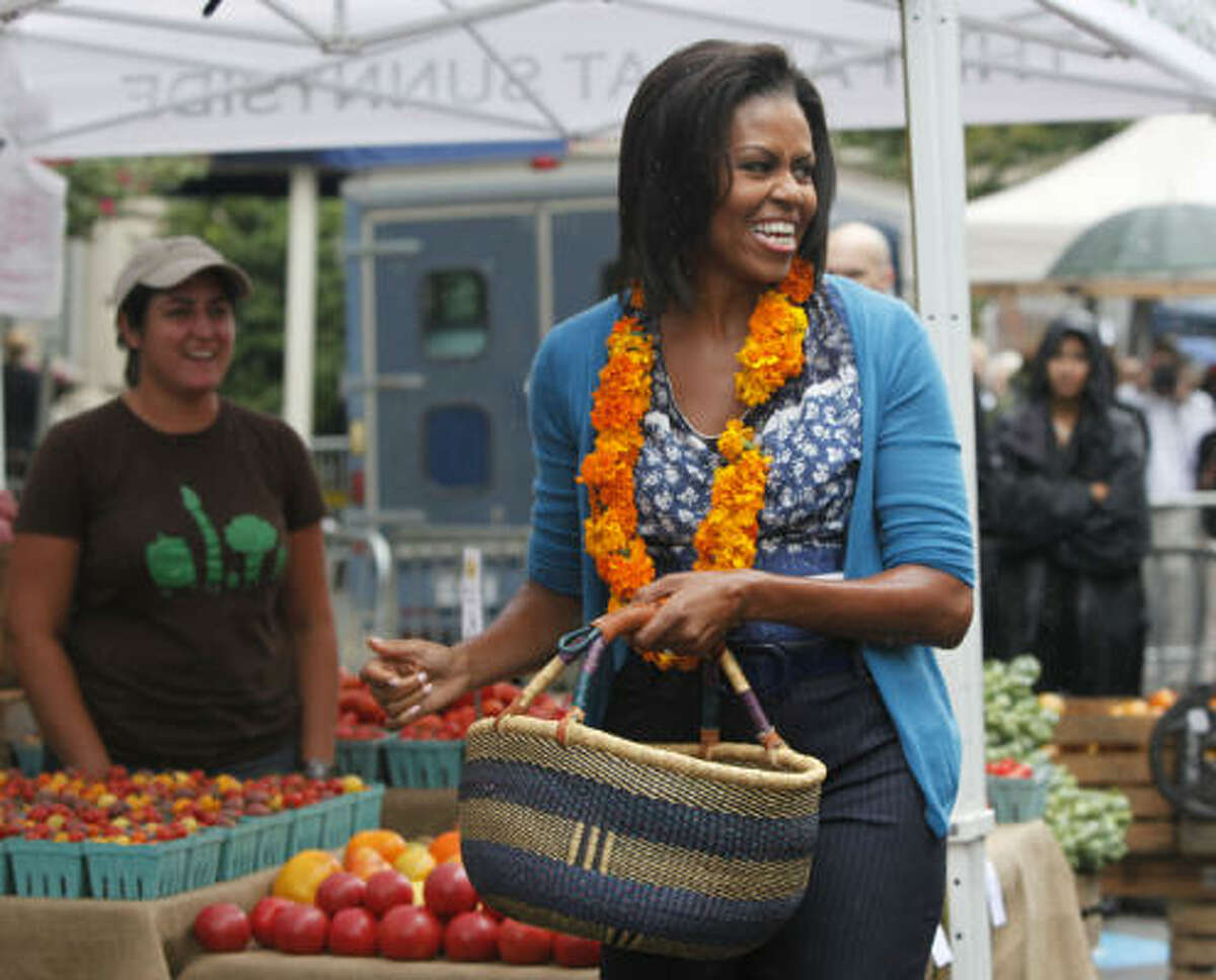 First lady Michelle Obama talks to people in the crowd as she picks some fresh produce from a stall. More: More about the new market | Houston-area farmer's markets | Houston Plant Database | HoustonGrows.com