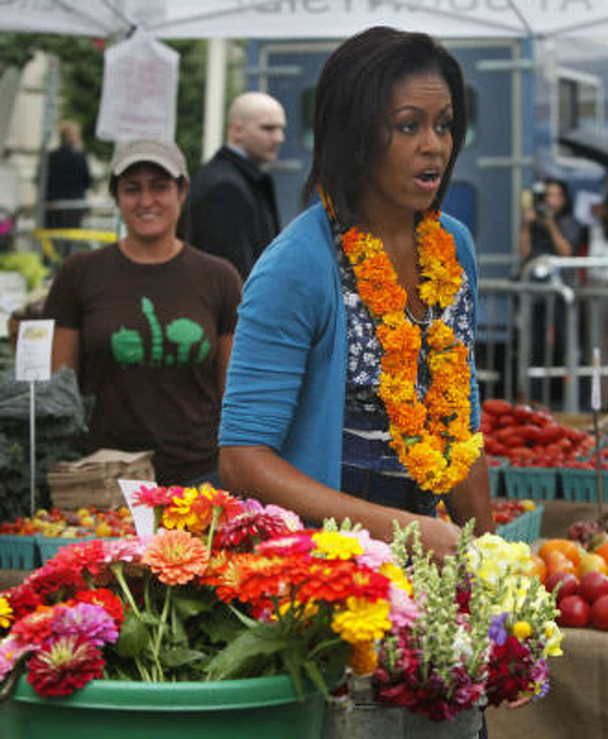 First lady Michelle Obama talks to the crowd as she chooses some flowers. More: More about the new market | Houston-area farmer's markets | Houston Plant Database | HoustonGrows.com