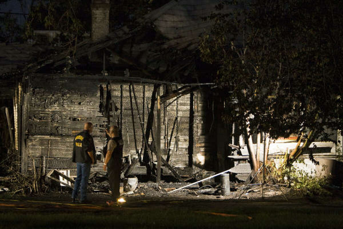 Arson investigaters work the scene of a fire at 12th Street and Herkimer.