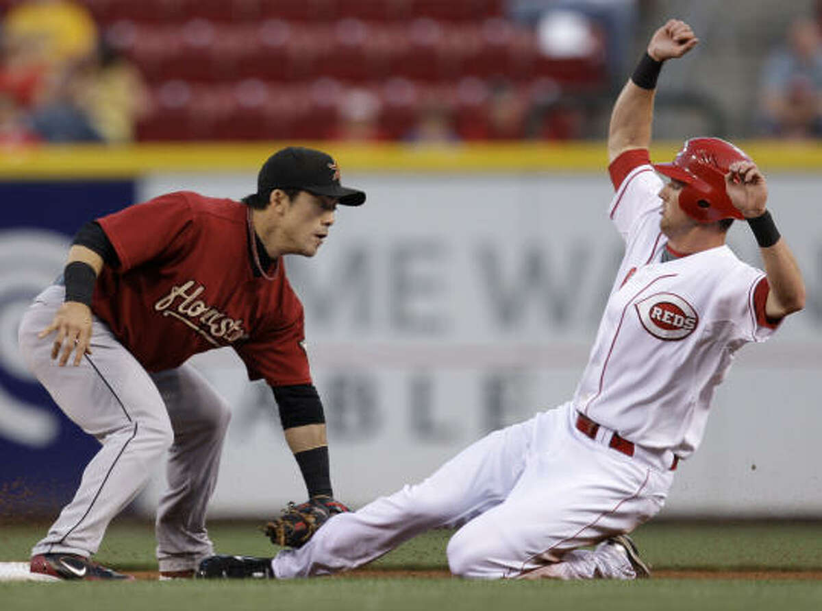 Astros second baseman Kazuo Matsui, left, tags out Cincinnati Reds' Drew Stubbs trying to steal second in the first inning.