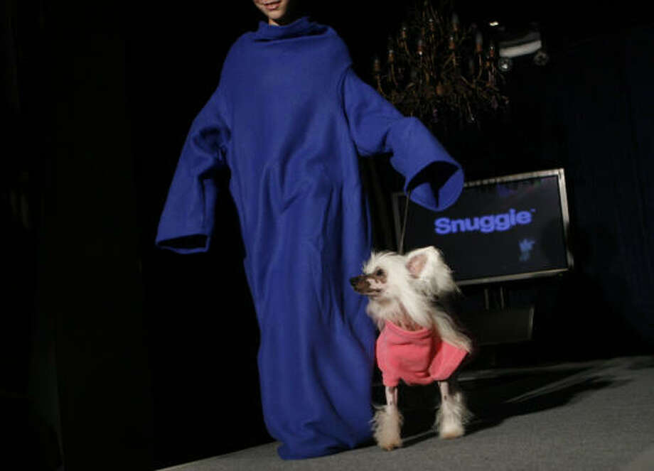 Forget the Snuggie, which was part of the fall 2009/winter 2010 collection show during Fashion Week Tuesday in New York. Take a look at the following five must-haves for stylish pups. Photo: Jason DeCrow, AP