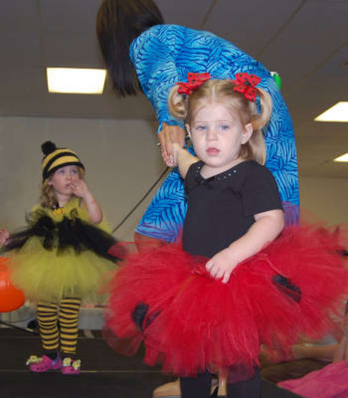 LAURA CENTER BENEFIT SHOW: A children's fall fashion show benefited the Laura Recovery Center Foundation. Karys Kinder, 2, back, is hesitant to head down the runway, but Julianne Melancon makes the route, headed straight for a strategically placed candy basket.