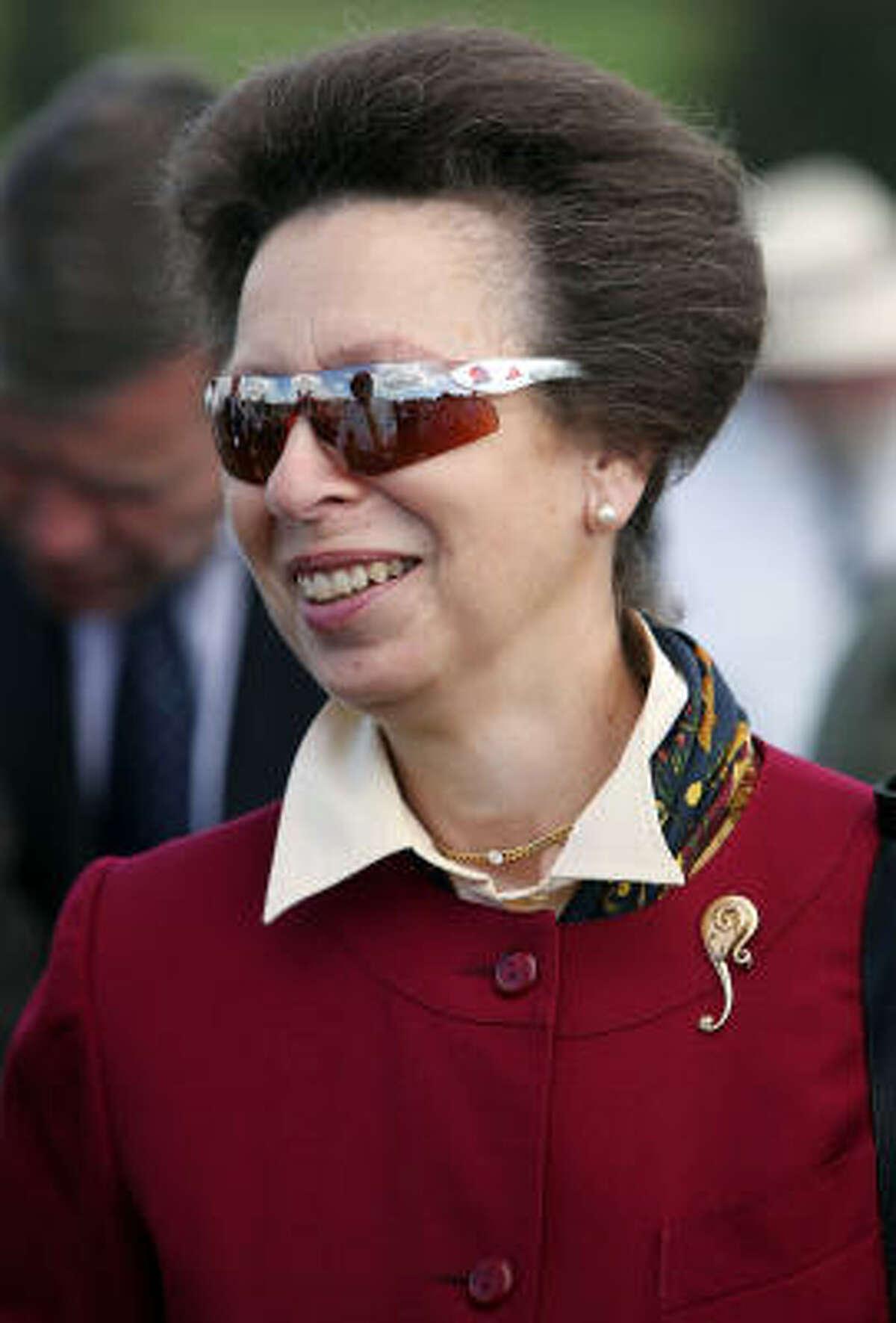 Princess Anne wears Team GB Olympic sunglasses.