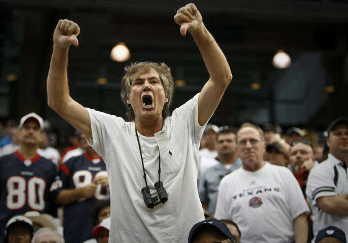 A Texans fans expresses his displeasure during the second quarter of the Houston Texans 24-7 loss to the New York Jets in their season opener at Reliant Stadium.