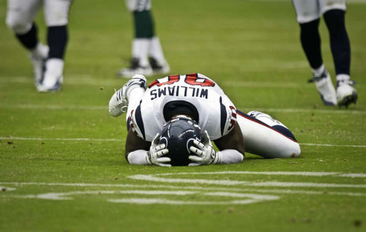 Houston Texans defensive end Mario Williams reacts after narrowly missing an interception during the second quarter.