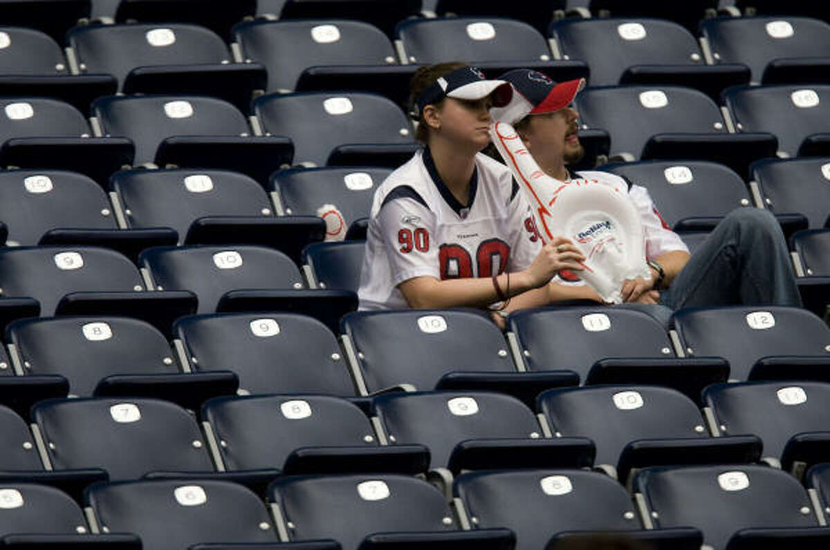 A couple of Texans fans remain in their seats after Sunday's game.