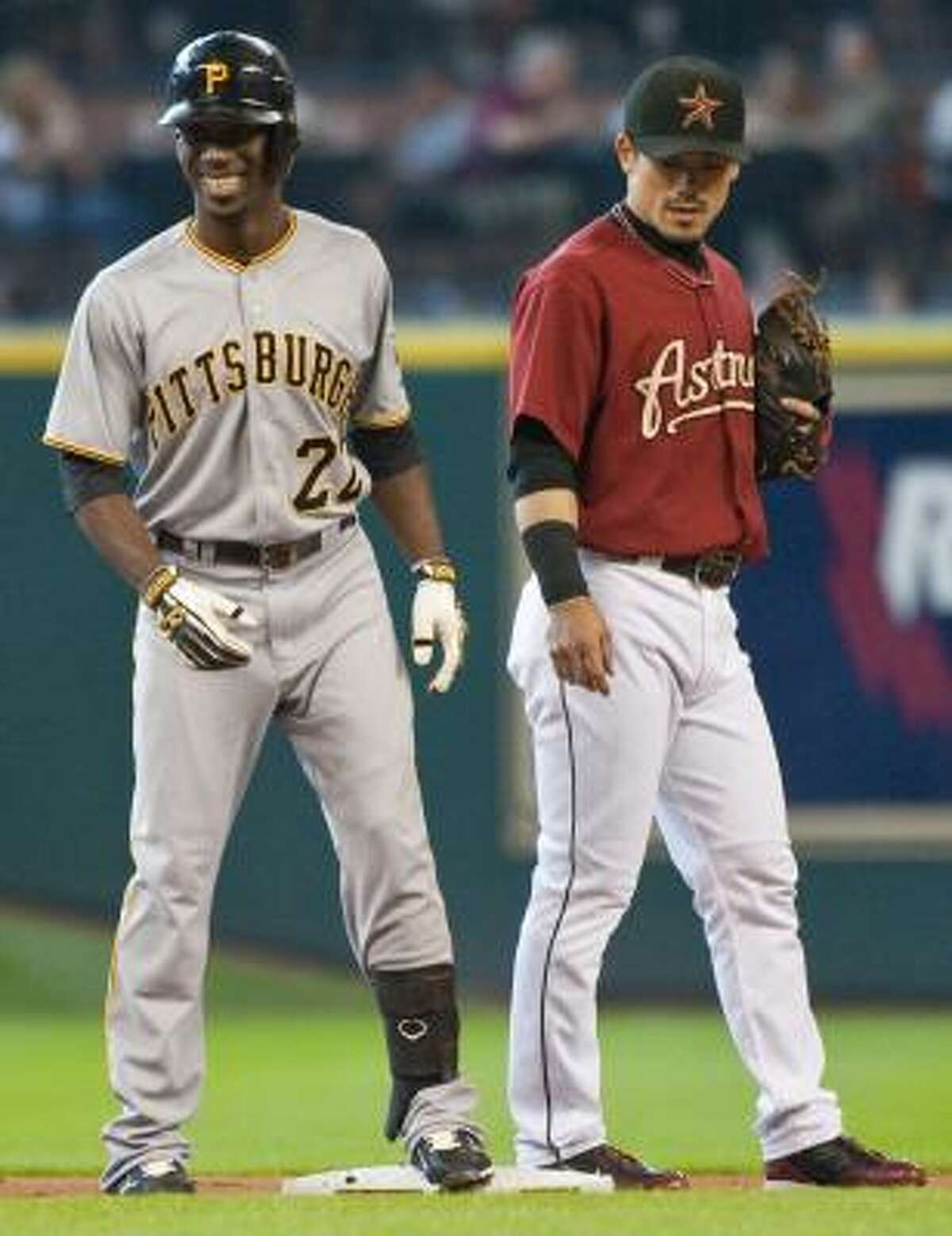 Game 3: Pirates 2, Astros 1 Pittsburgh Pirates' Andrew McCutchen, left, smiles after hitting a lead-off double during the first inning.