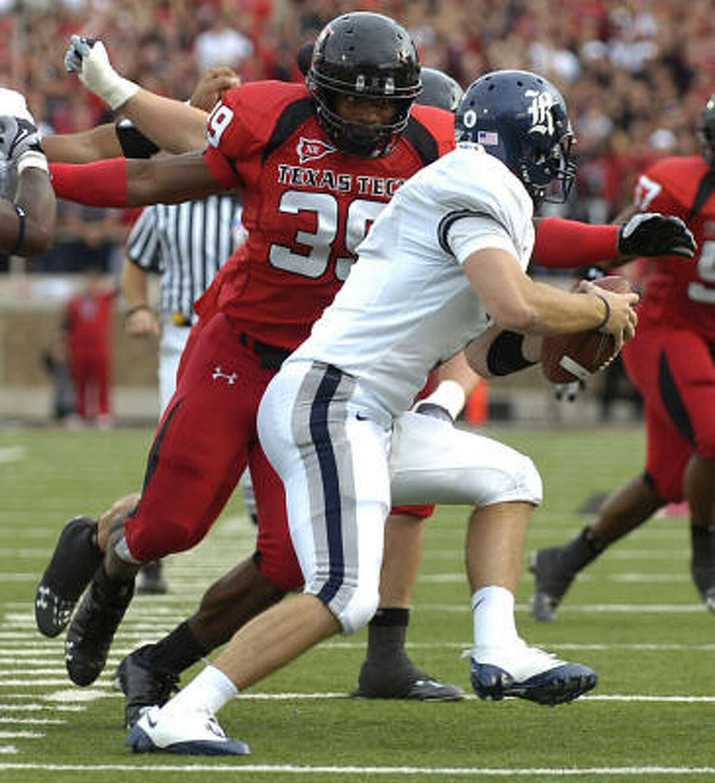 Texas Tech's Marlon Williams moves in to sack Rice's Nick Fanuzzi.