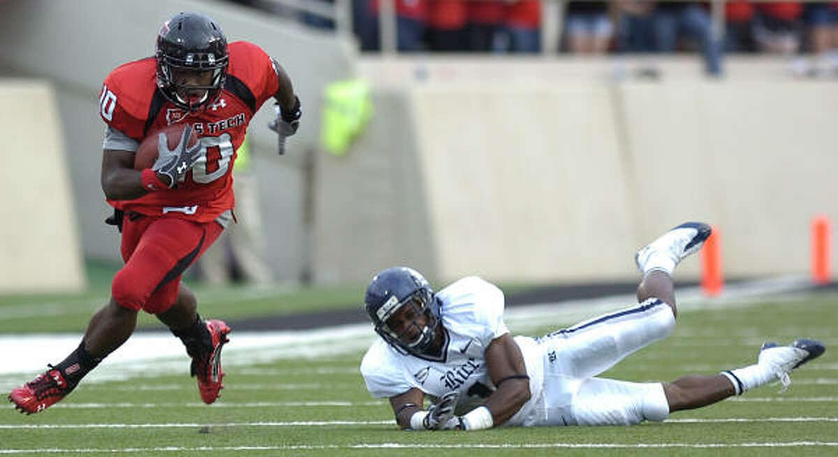 Texas Tech's Harrison Jeffers gets past Rice's Jarrett Ben.