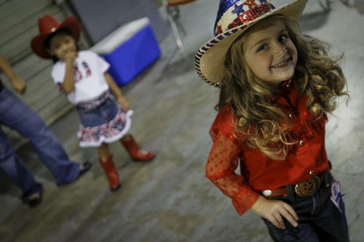 Emily Rahe, 4, waits backstage to compete.