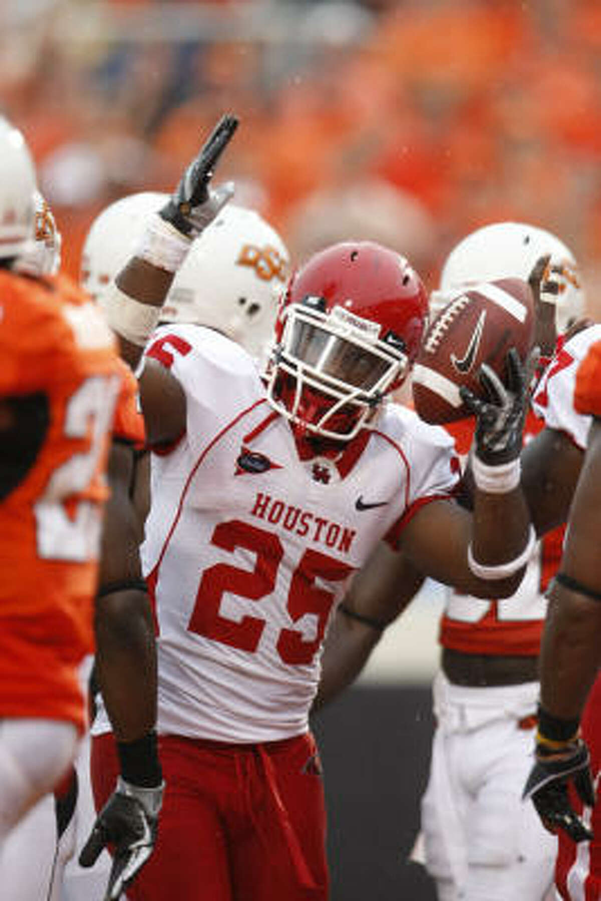 Houston running back Bryce Beall looks to the ref for the touchdown signal in the third quarter of Saturday's game against Oklahoma State.