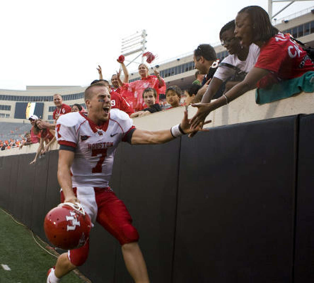 Houston quarterback Case Keenum clebrates with Houston fans after the victory.