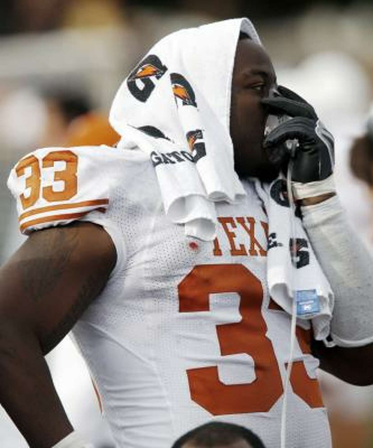 Texas defensive tackle Lamarr Houston gets some oxygen while on the sideline.